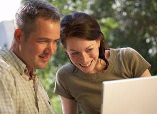 Couple looking at finances on laptop